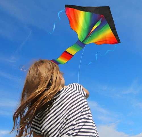 Young girl flying a kite at Cyherbia on Green Monday