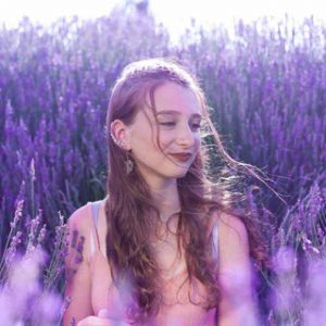young girl smiling in the beautiful lavender Garden of Cyherbia